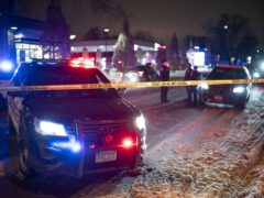 Police cars at the scene after a man was shot and killed by Minneapolis police at a petrol station on Wednesday (Jeff Wheeler/Star Tribune/AP)