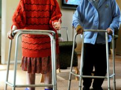 A couple of elderly residents at a nursing home, use zimmer frames (John Stillwell/PA)