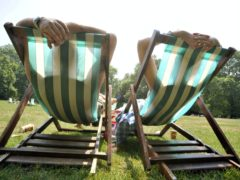 Tanning beds and sunbathing 'may be linked to increased risk of endometriosis' (Tim Ireland/PA)