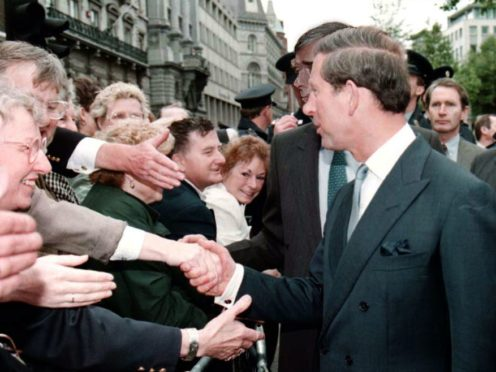 Eager Irish hands stretch out to greet the Prince of Wales as he goes for an informal walkabout along Dublin's College Green in 1995 (Martin Keene/PA)