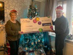 Diane Bate celebrates her £3.8m jackpot with husband Michael (National Lottery/PA)