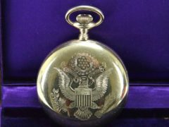 A 14-carat gold pocket watch presented by former US president Woodrow Wilson has been stolen from an antiques shop in north London (Metropolitan Police/PA)