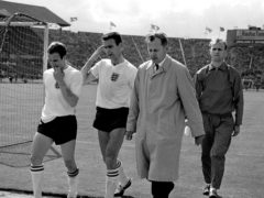 Former England defender Peter Swan (second left) has died at the age of 84 (PA)