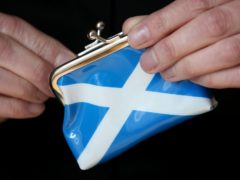 Funding coming to the Scottish Government has 'varied greatly' (Jane Barlow/PA)