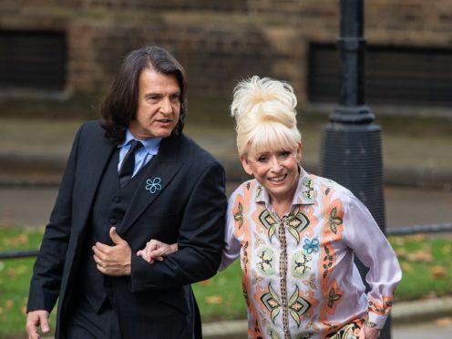 Dame Barbara Windsor and her husband Scott Mitchell (Dominic Lipinski/PA)