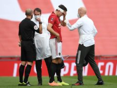 Manchester United's Harry Maguire receives treatment for a head injury during last season's FA Cup semi-final against Chelsea (Andy Rain/NMC Pool/PA)
