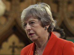 Theresa May has accused Boris Johnson of abandoning 'global moral leadership' (Daniel Leal-Olivas/PA)