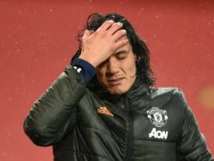 Manchester United striker Edinson Cavani was punished with a three-match ban and a £100,000 fine for his social media post (Oli Scarff/PA)