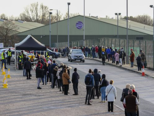 People queue at a Coronavirus testing centre at the Liverpool Tennis Centre in Wavertree (Peter Byrne/PA)