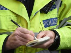 EMBARGOED TO 0001 WEDNESDAY NOVEMBER 18 File photo dated 22/10/14 of a police officer. More than three in five coronavirus fines have gone unpaid in some parts of England, figures suggest.