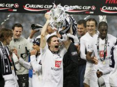 Robbie Keane lifts the League Cup trophy for Tottenham (Dave Thompson/PA)