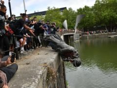 Black Lives Matter protesters throw the statue of Edward Colston into Bristol harbour in June last year (Ben Birchall/PA)