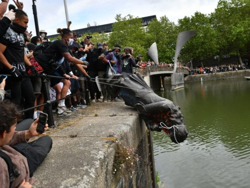 The statue was toppled before being thrown into the harbour (Ben Birchall/PA)