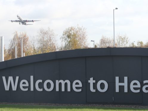 A plane above Heathrow Airport (Steve Parsons/PA)