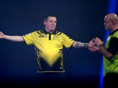 Dave Chisnall (left) is through to the PDC World Championship semi-finals for the first time following his victory over Michael Van Gerwen (right) (John Walton/PA).