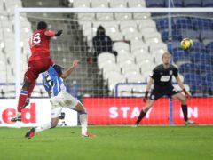 Reading's Lucas Joao (second left) scores the winner against Huddersfield (Martin Rickett/PA).