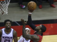 John Wall, right, was impressive for the Houston Rockets against the Sacramento Kings (Carmen Mandato/Pool/AP)