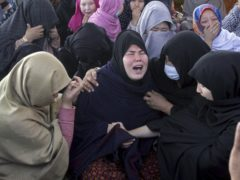 Women from the Shiite Hazara community mourn over death of their family members during a a sit-in protest against the killing of coal mine workers (Arshad Butt/AP)