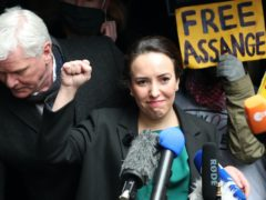 Stella Moris raises her fist outside the Old Bailey following the ruling that her fiance, Julian Assange, cannot be extradited to the US (Yui Mok/PA)