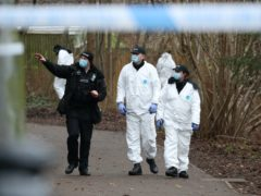 Police searching an alleyway near to where a 13-year-old boy died in Emmer Green, Reading, after being stabbed on Sunday (Jonathan Brady/PA)