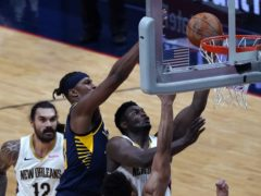 New Orleans Pelicans forward Zion Williamson goes to the basket against Indiana Pacers guard Justin Holiday in the second half of atheir NBA match on Monday, won by the Pacers (Gerald Herbert/AP)