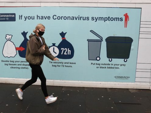 A coronavirus advice sign on North Bridge in Edinburgh (Andrew Milligan/PA)