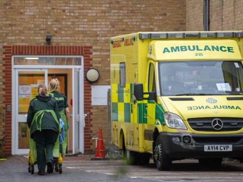 Paramedics transfer a patient from an ambulance into Southend University Hospital in Essex (Joe Giddens/PA)