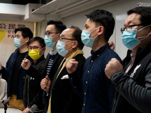 Pro-democratic party members shout slogans in response to the mass arrests during a press conference in Hong Kong last Wednesday (Vincent Yu/AP)