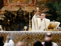 Pope Francis leads a Mass for the Feast of Epiphany in St Peter's Basilica (Remo Casilli/AP)