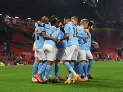 Manchester City's John Stones celebrates scoring the opening goal with team mates during the Carabao Cup Semi-Final match at Old Trafford, Manchester.