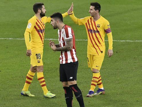 Lionel Messi (right) celebrates with teammate Jordi Alba after scoring in Barcelona's LaLiga victory at Athletic Bilbao (Alvaro Barrientos/AP)