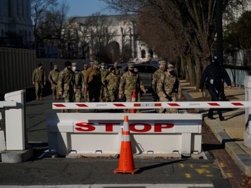 Members of the National Guard in the grounds of the Capitol the day after an attack by protesters loyal to President Donald Trump (Evan Vucci/AP)