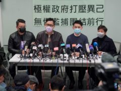 Former Democratic Party legislators Andrew Wan, left, Lam Cheuk-ting, second left, and Helena Wong, right, attend a news conference on Friday after being released on bail in Hong Kong (Kin Cheung/AP)