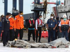 Rescuers inspect debris found in waters near where a Sriwijaya Air passenger jet crashed on Saturday (Achmad Ibrahim/AP)