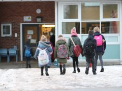 Pupils arriving at Manor Park School and Nursery in Knutsford, Cheshire (PA)