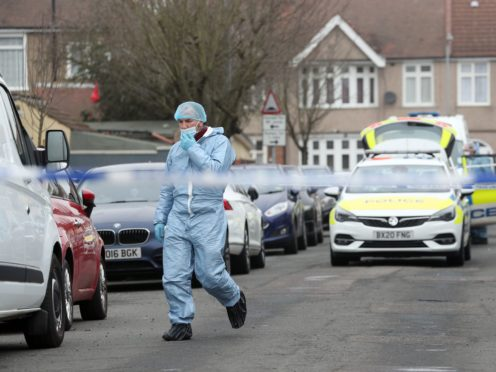 Forensic officers at the scene in Tavistock Gardens (Jonathan Brady/PA)