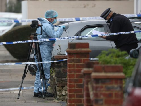 A forensic officer at the scene in Tavistock Gardens, Ilford (Jonathan Brady/PA)