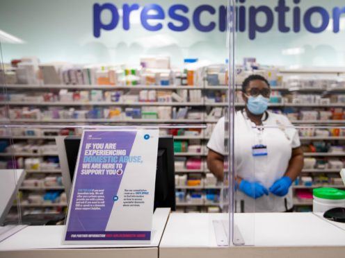 Signage for Ask for Ani at the pharmacy desk in a Boots store (David Parry/PA)