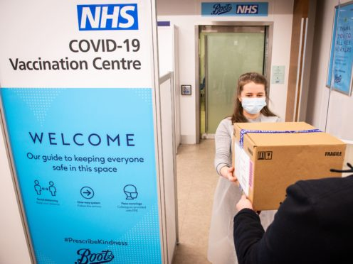 Local pharmacies are the latest part of the health service to join England's coronavirus vaccination rollout (Will Johnston/Boots/PA)