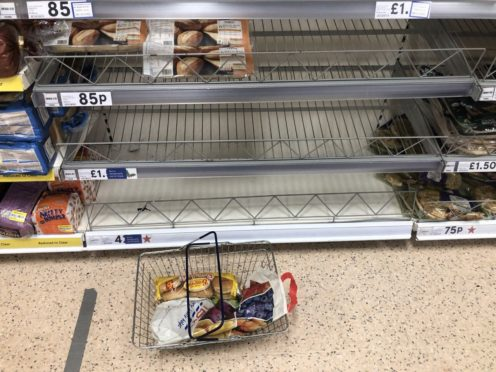 Empty food shelves at a Tesco store in Banbridge, Northern Ireland (Brian Lawless/PA)