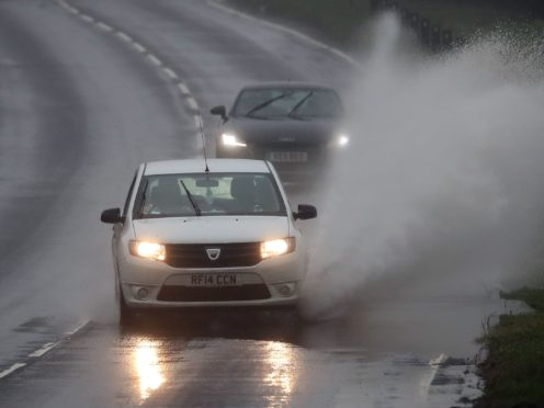 Large swathes of the UK are set to be hit with heavy downpours next week (Gareth Fuller/PA)