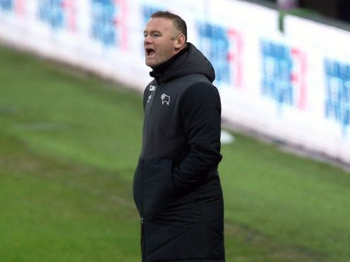 Wayne Rooney suffered defeat in his first game in permanent charge of Derby (Nigel French/PA).
