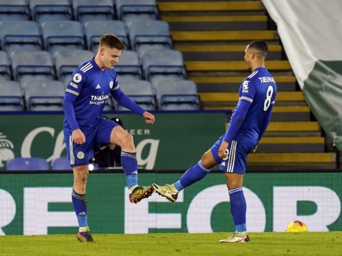 Harvey Barnes celebrates with Youri Tielemans by touching boots (Tim Keeton/PA)