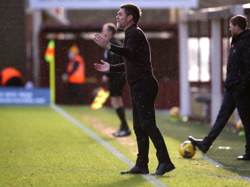 Motherwell manager Graham Alexander saw his side robbed of victory against Rangers because of a linesman's mistake (Andrew Milligan/PA)