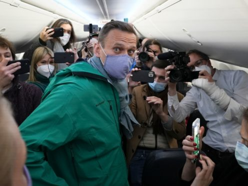 Alexei Navalny surrounded by journalists inside the plane prior to his flight to Moscow (Mstyslav Chernov/AP)