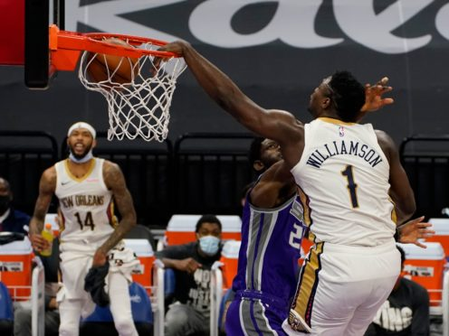 Zion Williamson, right, had 31 points as his New Orleans Pelicans had a well-deserved 128-123 win over the Sacramento Kings (Rich Pedroncelli/AP)