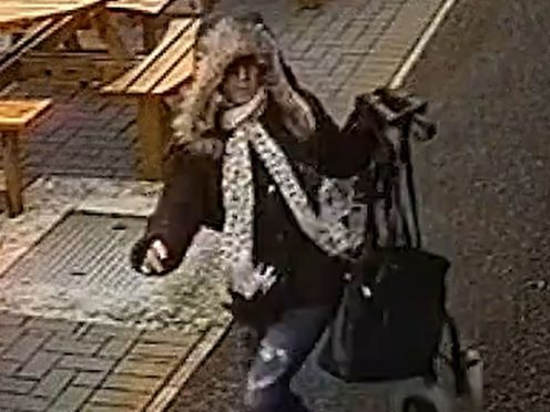 Kirsty Moxon running away from the scene with a handbag (South Yorkshire Police/PA)