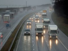 Traffic in heavy rain in West Yorkshire (Danny Lawson/PA)