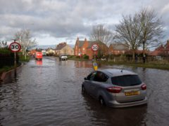 Stranded cars in floodwater on Derby Road in Hathern, Leicestershire (Joe Giddens/PA)