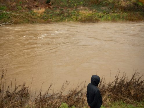 The River Severn close to bursting its banks in Newtown, Mid Wales (Jacob King/PA)